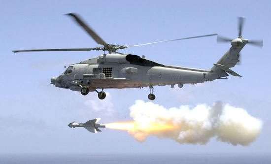 Firing of an AGM-119 Penguin anti-ship missile from an SH-60B Sea Hawk helicopter, during aircrew weapon certifications. US Navy, Pacific Ocean off the Coast of Okinawa, Japan (Jul. 23, 2002).